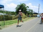 Olympic Male Champion in 2004 St Kitts Triathlon sprinting towards the finish line