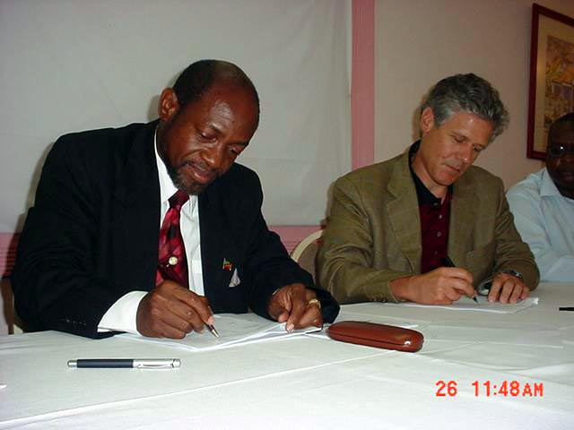 St. Kitts and Nevis' Prime Minister and Minister of Tourism, Dr. the Hon. Denzil L. Douglas (l) and Chief Executive Officer of Auberge Resorts, Mr. Mark Harmon sign the Agreement for the Whispering Head Resort Development, a St Kitts small luxury resort development on the South East Peninsula.
