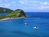 St Kitts Beaches - White House Bay showing two boats anchored in the bay and Guana Point in the background.