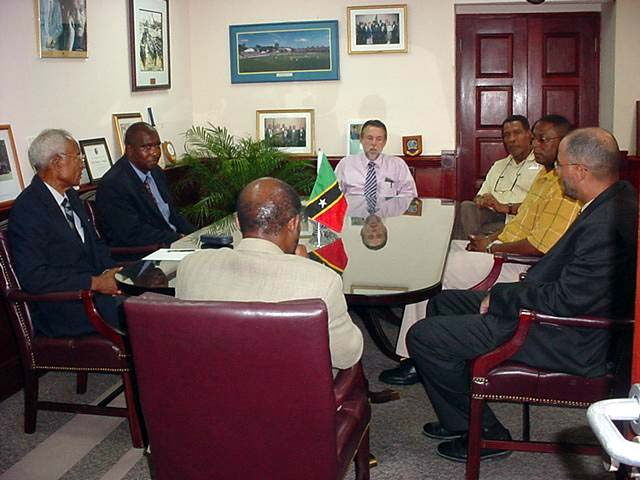 Prime Minister Douglas and Senator Richard Ricky Skerritt and St Kitts Nevis Cricket Officials with West Indies Cricket Board President Ken Gordon