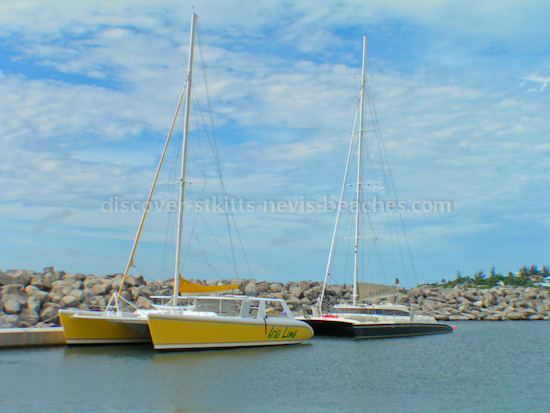 Photo of Irie Lime and Spirit of St. Kitts Catamarans docked at Port Zante Marina in St. Kitts.