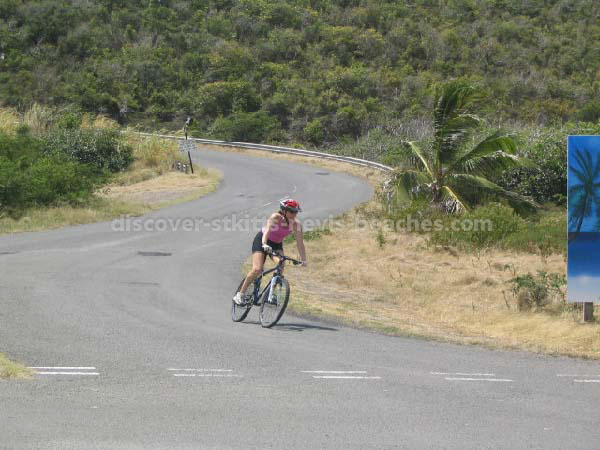 Female participant on bike in the 2004 St Kitts Triathlon
