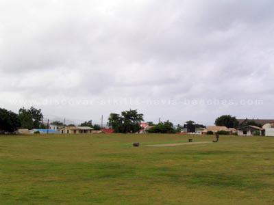The old cricket pitch at Warner Park with the south eastern section in the background.  Today, the Carib Party Mound occupies the south eastern section of the Warner Park Cricket Grounds.