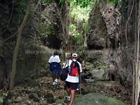 Hiking up Bloody Point River in Challengers St. Kitts.  Ancient rock drawings adorn portions of the walls of the ravine. The river was also the site of a fierce battle between the Caribs and the British.