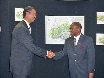 St. Kitts and Nevis Prime Minister and Minister of Tourism, Dr. the Hon. Denzil L. Douglas (r) and Managing Director of Belmont Resorts Limited Mr. Valmiki Kempadoo shaking hads after signing the Agreement.