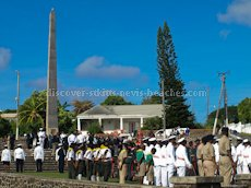 St Kitts heritage sites photos - The Cenotaph located at Fortlands in Basseterre St Kitts is a memorial to those from St. Kitts, Nevis and Anguilla who gave their lives in the First and Second World Wars. A remembrance ceremony (pictured here) is held on the second Sunday of November every year.