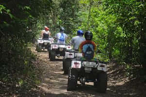 Riding in the rainforest on St Kitts quad bike tour