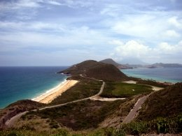 St Kitts tours and Island Safaris with Captain Sunshine Tours. St Kitts photo of Captain Sunshine Tours St Kitts Panoramic Tour showing the Southeast peninsula as seen from the Timothy Hill lookout point with views of the Atlantic Ocean and the Caribbean Sea .