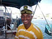 St Kitts tours and Island Safaris with Captain Sunshine Tours. St Kitts photo of Captain Sunshine tour guide Kenny aka Smiling Kenny.
