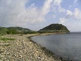 St Kitts Beaches - White House Bay showing rocky shoreline and small sandy section at southen end with Guana Point in the background.